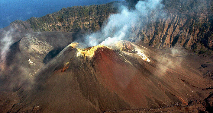 Smoke rises from the Barren Island volcano, 135 kilometers (84 miles) east of Port Blair, India on Sunday, March 25, 2007