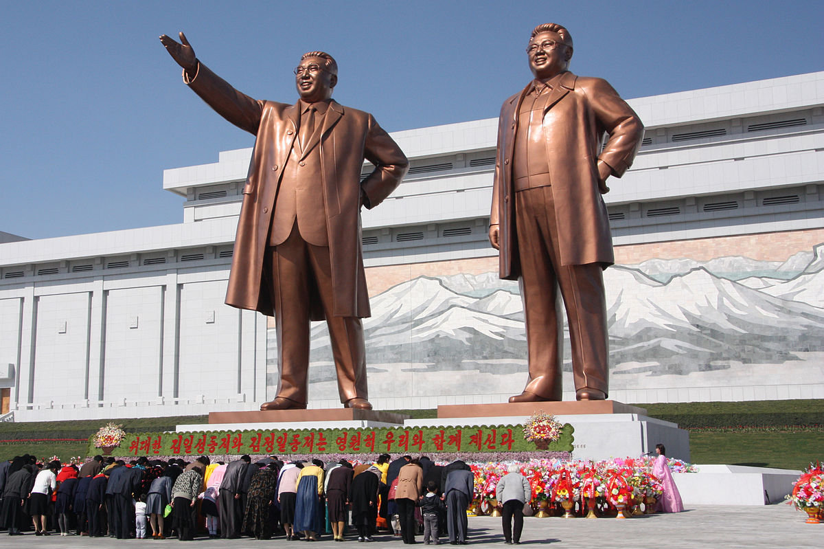 North Koreans bowing to the statues of Kim Jong-il and his father, Kim Il-sung, at the Mansu Hill Grand Monument