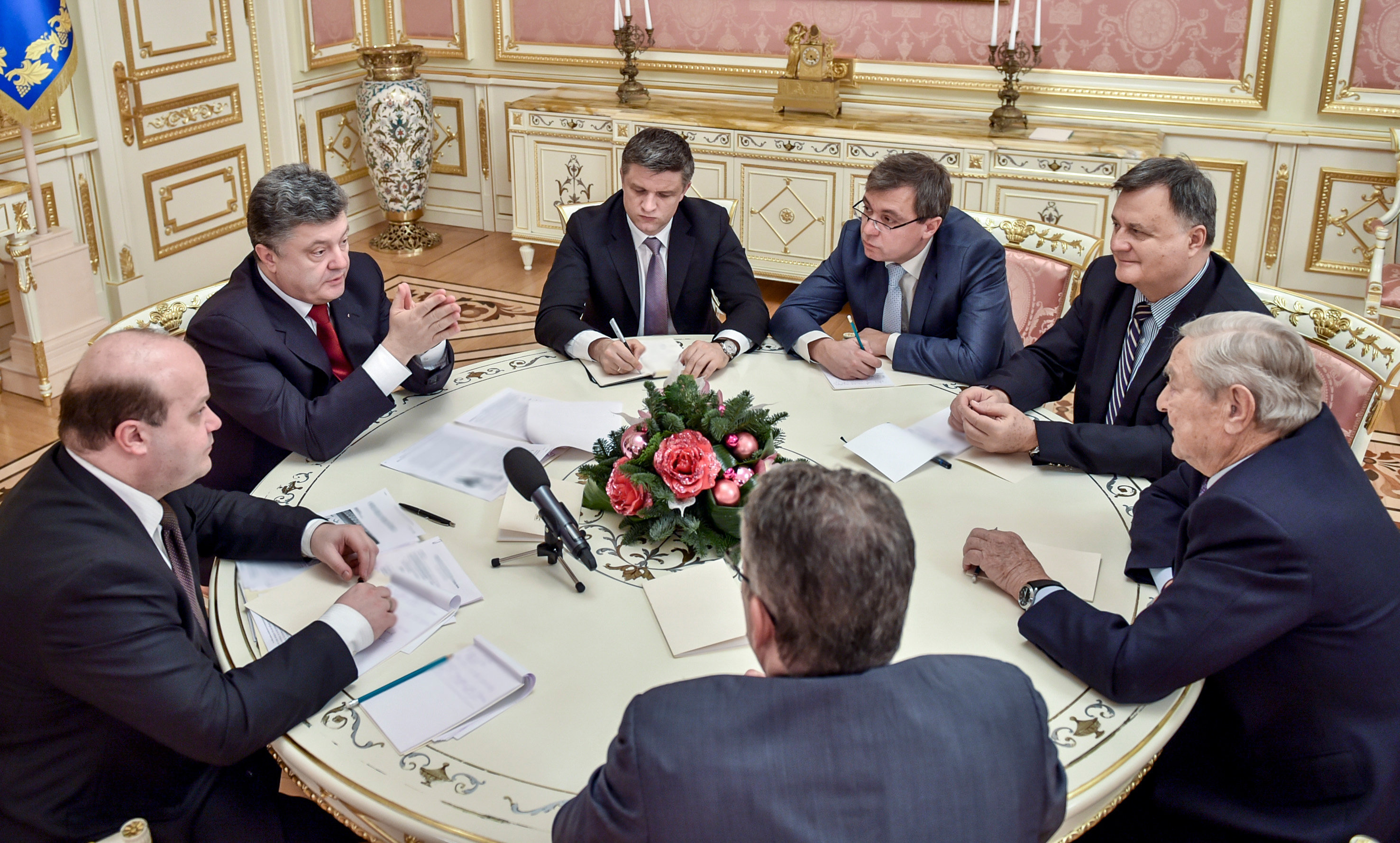 Ukrainian President Petro Poroshenko (second left) and George Soros (right), founder and chairman of the Open Society Foundations, during a meeting in Kiev