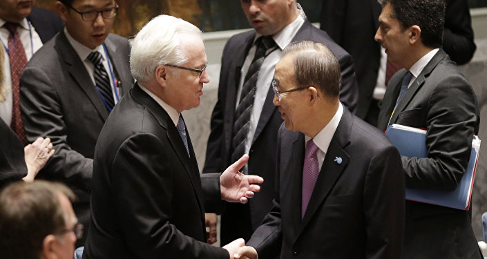 United Nations Secretary-General Ban Ki-moon, right, greets Russia's Ambassador to the UN Vitaly Churkin before a Security Council meeting at United Nations headquarters, Wednesday, Sept. 30, 2015