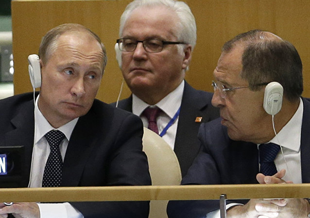 Russia's President Vladimir Putin, left, Foreign Minister Sergei Lavrov, right, and Ambassador to the United Nations Vitaly Churkin listen to speakers during the 70th session of the United Nations General Assembly at UN headquarters, Monday, Sept. 28, 2015