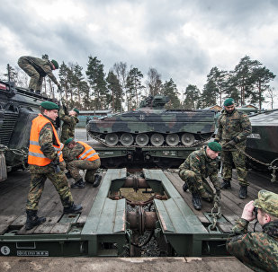 German soldiers load armored vehicles of the type Marder on a train at the troop exercise area in Grafenwoehr, southern Germany, on February 21, 2017