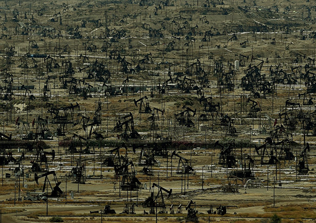An oil field with a large number of pumping jacks operating in the Central Valley of California is seen on June 24, 2015