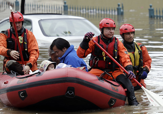 Rescue crews take out residents from a flooded neighborhood Tuesday, Feb. 21, 2017, in San Jose, Calif.