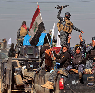 Iraqi security forces regroup in the village of al-Buseif, south of Mosul, during an offensive by Iraqi forces to retake the western side of the city from Daesh on February 22, 2017