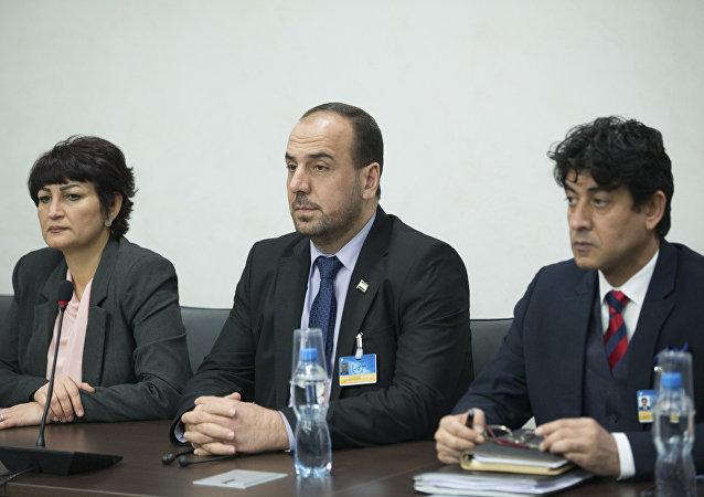Syria's opposition delegation head Nasr al-Hariri, center, attends the Syria peace talks with U.N. Special Envoy for Syria Staffan de Mistura at the Palais des Nations in Geneva, Switzerland