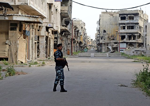 A police officer patrols a street in Homs. (File)