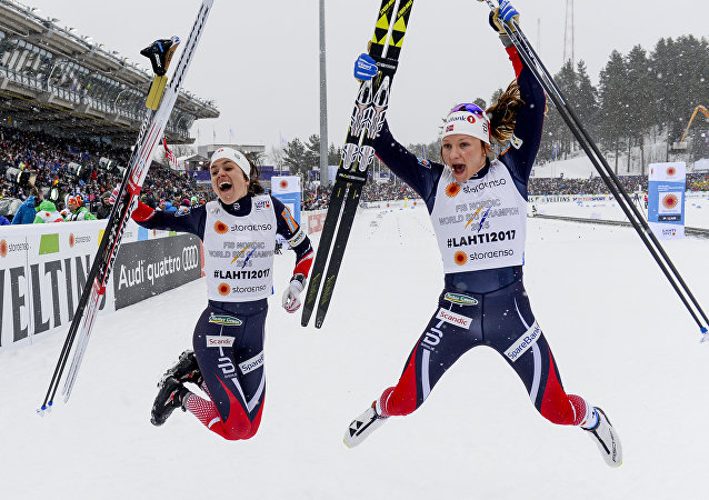 Team of Norway Heidi Weng (L) and Maiken Caspersen Falla celebrate after winning the women's Team Sprint event of the 2017 FIS Nordic World Ski Championships in Lahti, Finland, on February 26, 2017