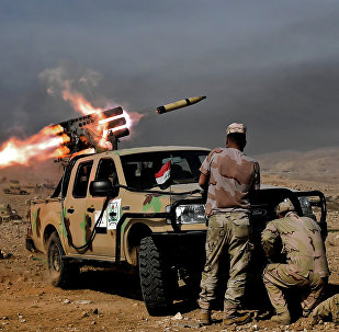 Members of the Iraqi army's 9th Division fire a multiple rocket launcher from a hill in Talul al-Atshana, on the southwestern outskirts of Mosul, on February 27, 2017, during an offensive to retake the city from Islamic State (IS) group fighters