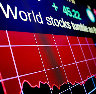 Electronic boards display the days loss to the Dow Jones Industrial Average (DJI) above the floor of the New York Stock Exchange (NYSE) in New York, U.S. (File)