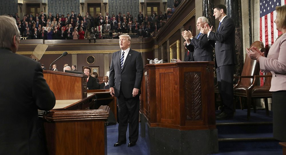 U.S. President Donald Trump is applauded after delivering his first address to a joint session of Congress from the floor of the House of Representatives iin Washington, U.S., February 28, 2017