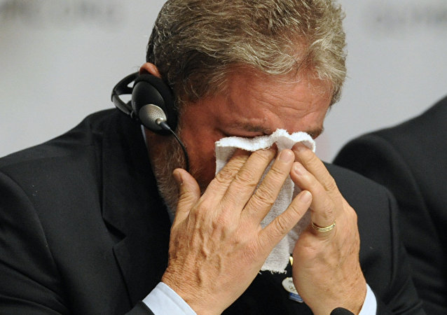 Brazilian President Luiz Inacio Lula da Silva cries at the press conference after Rio won the right to host the 2016 Olympic games, on October 2, 2009 in Copenhagen