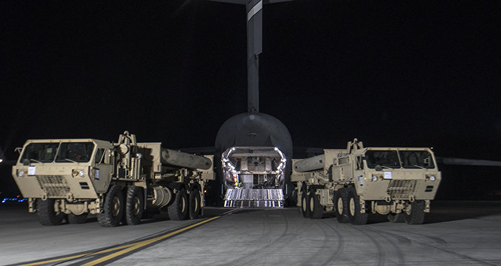 In this photo provided by US Forces Korea, trucks carrying US missile launchers and other equipment needed to set up the Terminal High Altitude Area Defense (THAAD) missile defense system arrive at the Osan air base in Pyeongtaek, South Korea.