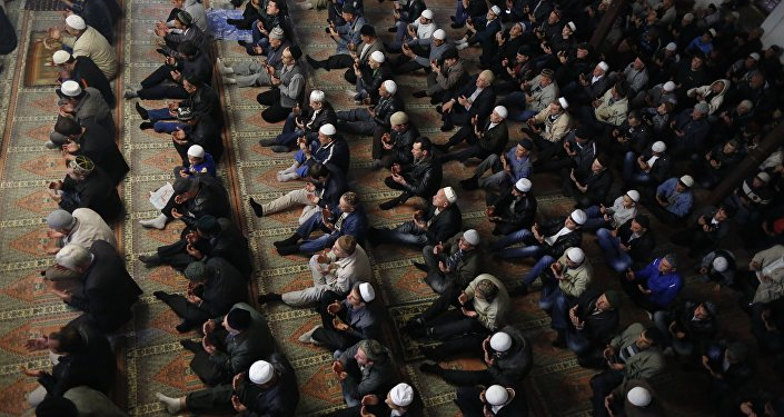 Crimean Tatars pray in a mosque marking the Eid al-Adha, celebrated by Muslims worldwide, in Bakhchisarai, Crimea. (File)