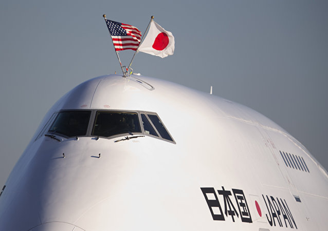 The flags of the United States and Japan are flown atop the plane carrying Japanese Prime Minister Shinzo Abe, as it arrives at Andrews Air Force Base, Md., Thursday, Feb. 21, 2013