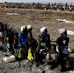 Women and children wait to be registered prior to a food distribution carried out by the United Nations World Food Programme (WFP) in Thonyor, Leer state, South Sudan, February 26, 2017