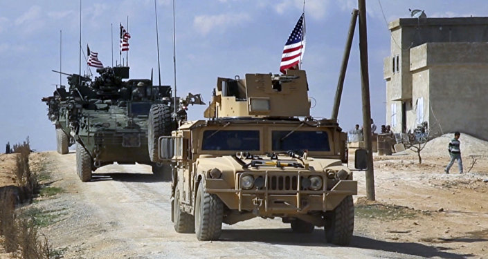 This Tuesday, March 7, 2017 frame grab from video provided by Arab 24 network, shows U.S. forces patrol on the outskirts of the Syrian town, Manbij, a flashpoint between Turkish troops and allied Syrian fighters and U.S.-backed Kurdish fighters, in al-Asaliyah village, Aleppo province, Syria