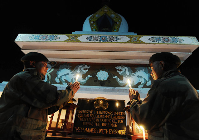 Indian Army personnel light candles in memory of those soldiers who sacrificed their lives in the 1962 Indo-China war at the Tawang War Memorial in Arunachal Pradesh
