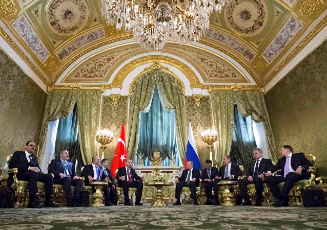Members of Russian and Turkish delegations, led by Presidents Vladimir Putin (5th R) and Tayyip Erdogan (5th L), attend a meeting at the Kremlin in Moscow, Russia, March 10, 2017