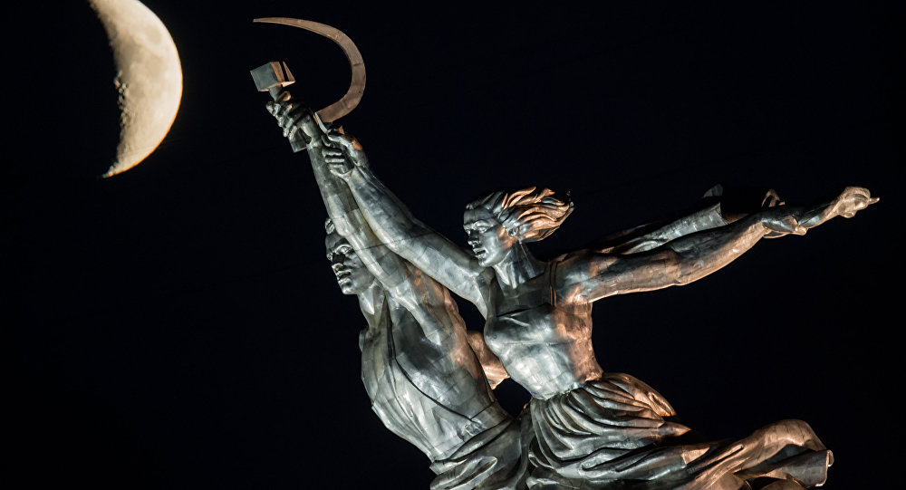 Worker and Collective Farm Woman monument and waxing moon in Moscow