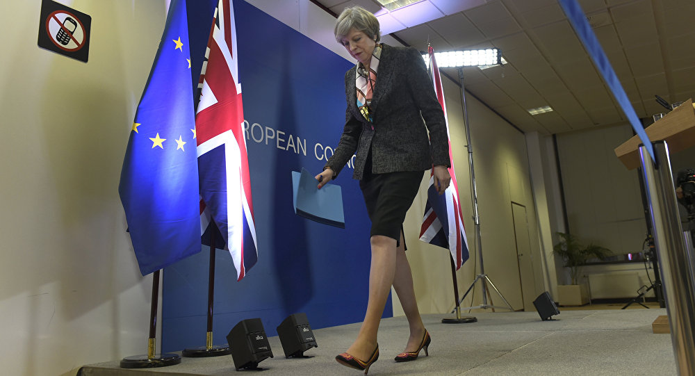 British Prime Minister Theresa May leaves after a press conference during a European Summit at the EU headquarters in Brussels on March 9, 2017