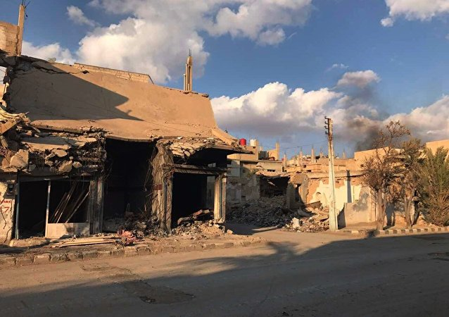 Buildings destroyed during combat activities in the residential part of Ancient Palmyra in Homs Governorate, Syria