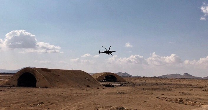 Russia's Mi-28 helicopter flies over the environs of Ancient Palmyra in Homs Governorate, Syria. File photo