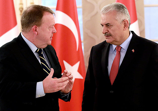 Picture taken on December 10, 2016 shows Turkish Prime Minister Binali Yildirim (R) speaking with his Danish counterpart Lars Lokke Rasmussen after a press conference following their meeting at the Cankaya Palace in Ankara.