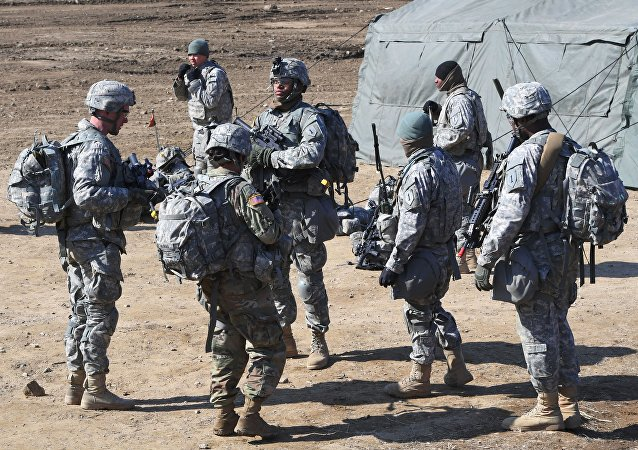 US soldiers gather during their drill at a military training field in the border city of Paju on March 7, 2017.