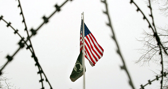 The US flag is seen through barbed wire in front of the US General Consulate in Frankfurt, central Germany. (File)