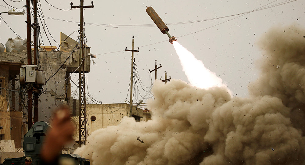 Iraqi rapid response members fire a missile against Daesh militants during a battle with the militants in Mosul, Iraq, March 11, 2017.