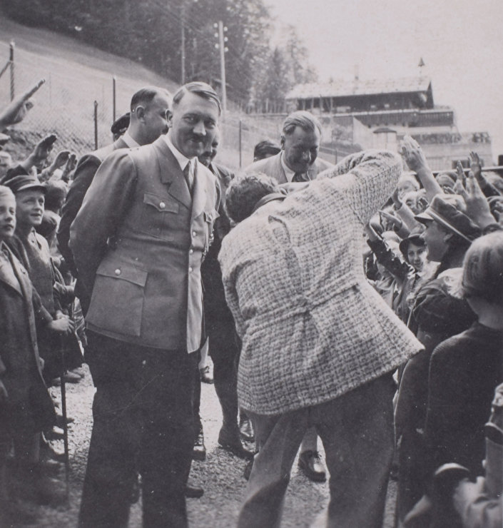 A smiling Hitler surrounded by schoolchildren at the Berghof