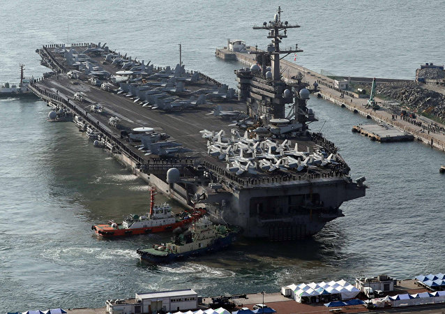 The US aircraft carrier USS Carl Vinson arrives for an annual joint military exercise called 'Foal Eagle' between South Korea and U.S, at the port of Busan, South Korea, March 15, 2017