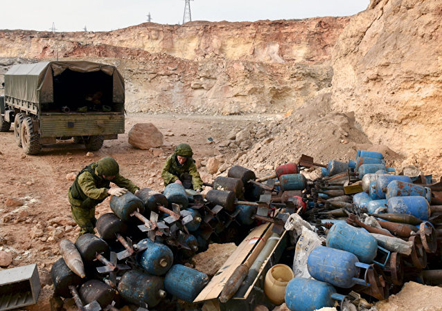 Russian combat engineers defuse explosive devices in Aleppo's residential areas