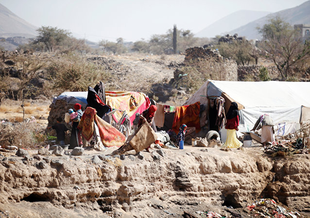 People are pictured near their tent at a camp for internally displaced people in Dharawan, near the capital Sanaa, Yemen, February 28, 2017