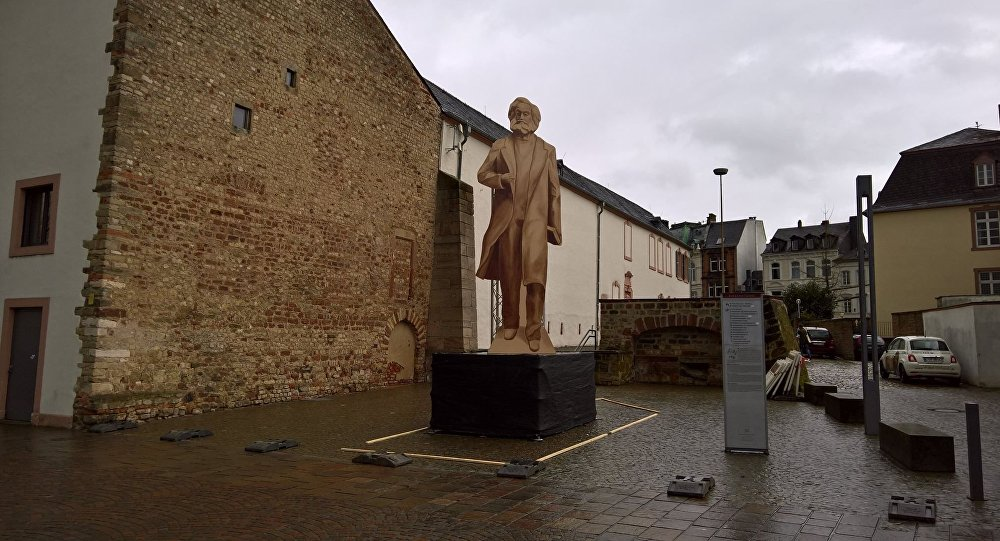 A wooden representation of the planned Karl Marx statue stands in Trier