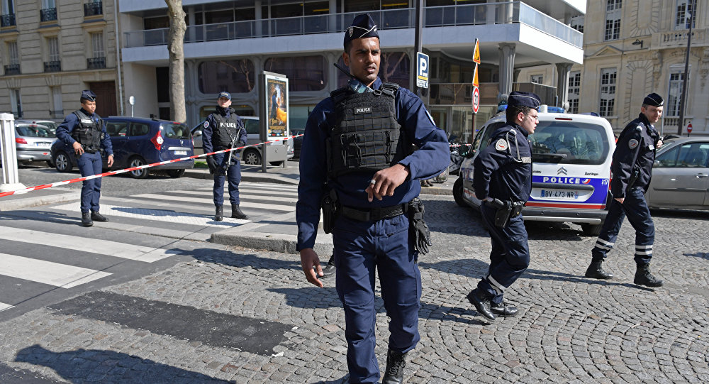 French Police officers secure the scene near the Paris offices of the International Monetary Fund (IMF) on March 16, 2017 in Paris, after a letter bomb exploded in the premises