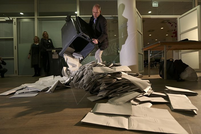 Ballots are emptied for counting as polling stations close in The Hague, Netherlands, March 15, 2017.