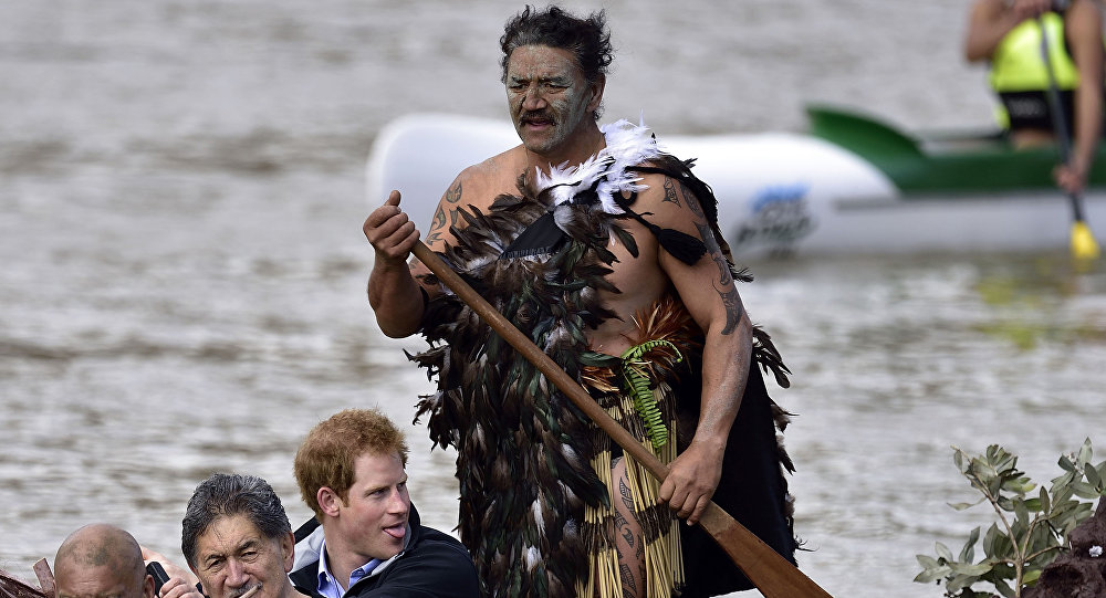 Britain's Prince Harry (2nd R) paddles in a waka (Maori war canoe) on the Whanganui river during a visit to Whanganui on May 14, 2015. Prince Harry arrived in New Zealand on May 9 for a week-long visit.