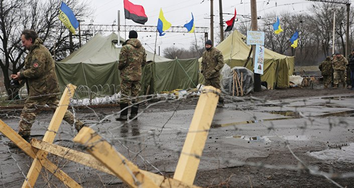 (File) Ukrainian nationalist protesters and military veterans take part in a blockade against ongoing trade with the Donbass self-proclaimed republics, on February 23, 2017, in Kryvyi Torets railway station, Donetsk region