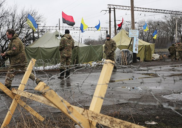 Ukrainian nationalist protesters and military veterans take part in a blockade against ongoing trade with the Donbass self-proclaimed republics, on February 23, 2017, in Kryvyi Torets railway station, Donetsk region
