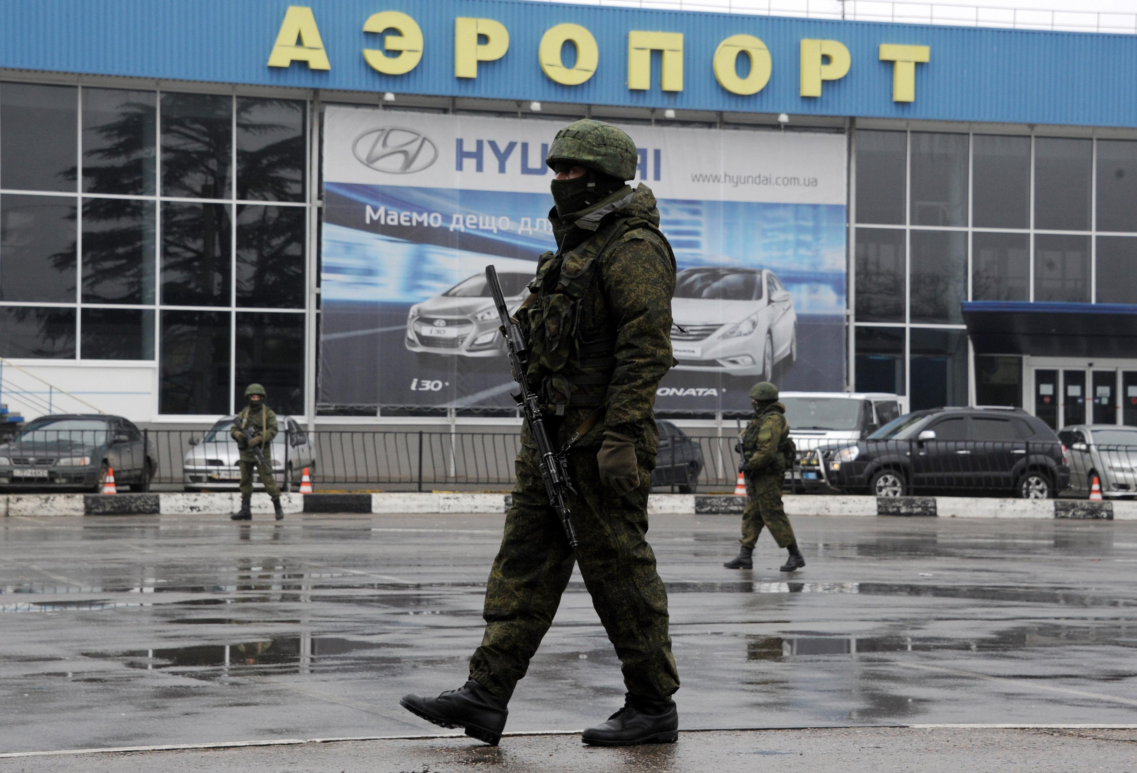 Unidentified armed men patrol outside of Simferopol airport, on February 28, 2014