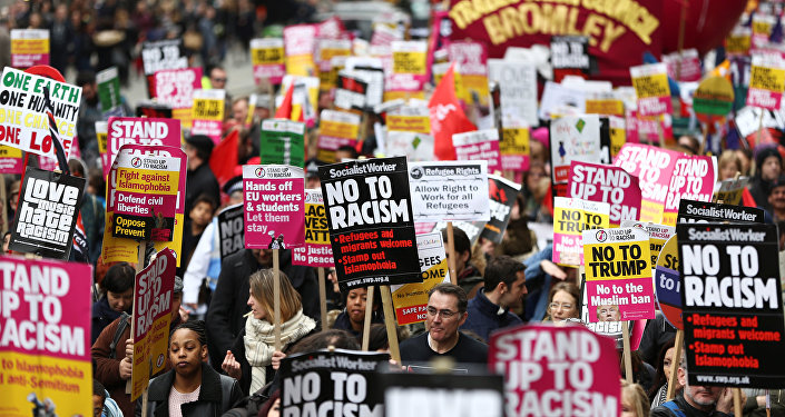 Protestors take part in a demonstration against racism in London, Britain, March 18, 2017