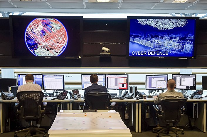 People sit at computers in the 24 hour Operations Room inside GCHQ, Cheltenham in Cheltenham, November 17, 2015.
