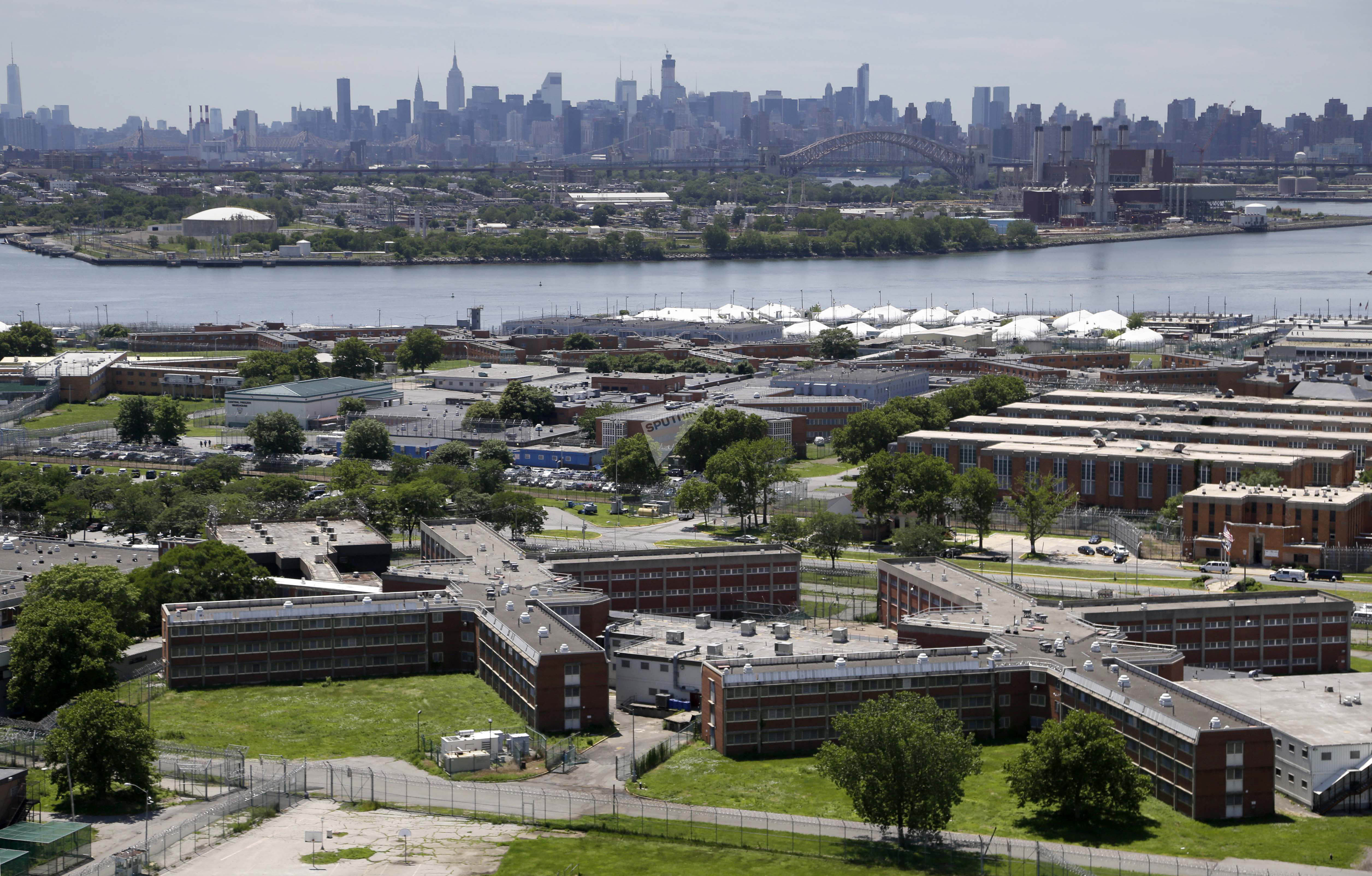 Rikers Island jail complex stands in the foreground with the New York skyline in the background. (File)