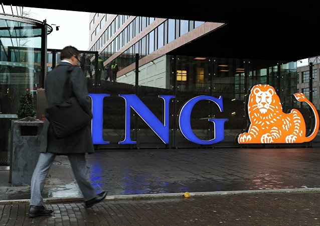 An employee arrives at the Dutch bank ING in Amsterdam