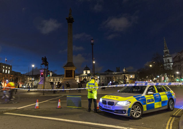 A British police officers stands on duty at a cordonned off road, leading towards Parliament Square, in central London on March 22, 2017, in the aftermath of a terror incident at Parliament.