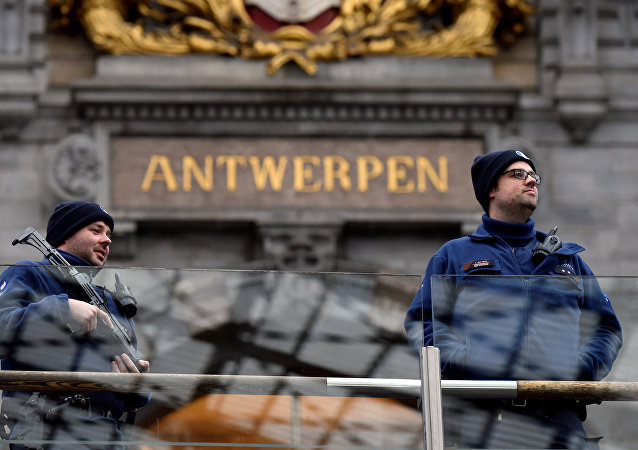 Belgian police officers patrol in the central station, in Antwerp, Belgium