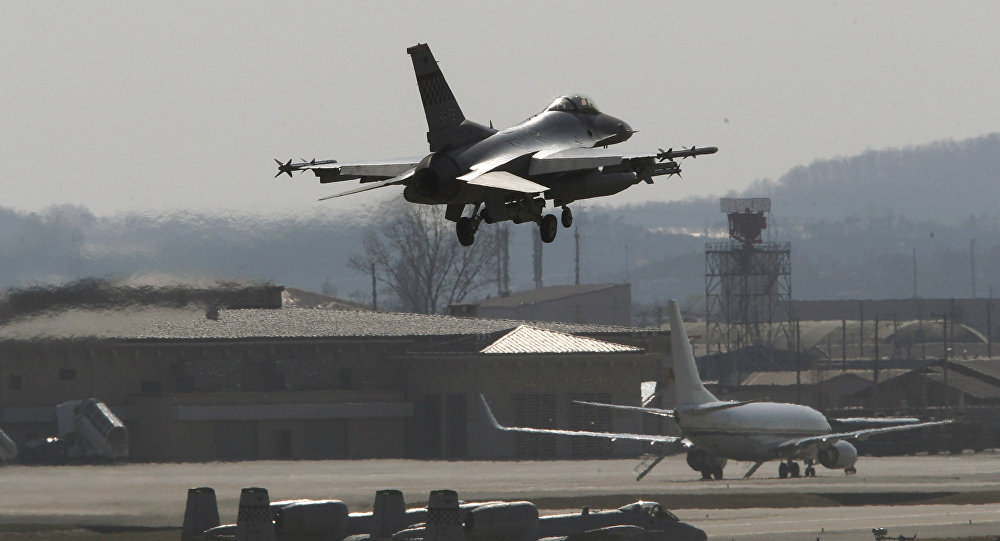 A U.S. Air Force F-16 fighter jet prepares to land on the runway during a military exercise at the Osan U.S. Air Base in Osan, South Korea, Wednesday, April 10, 2013