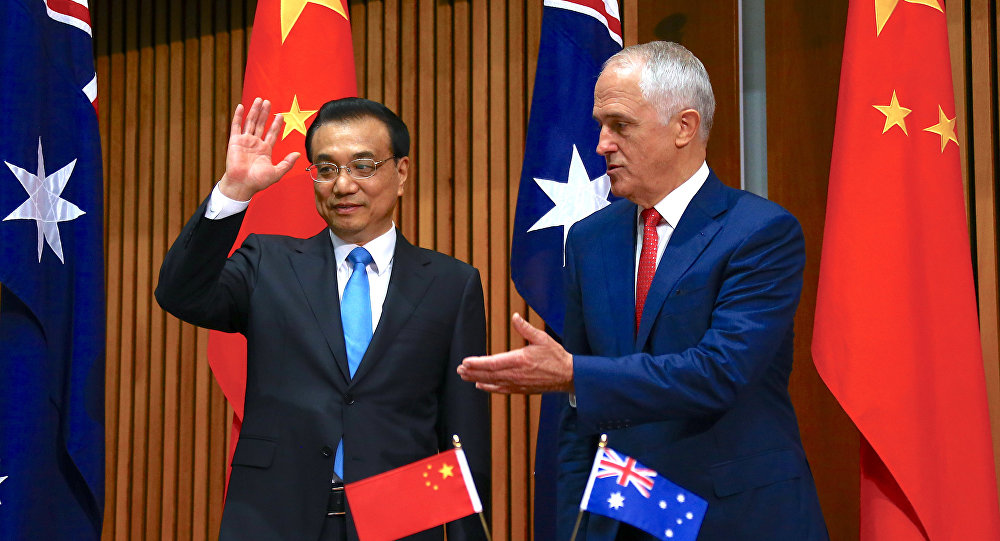Australia's Prime Minister Malcolm Turnbull gestures to Chinese Premier Li Keqiang at the end of an official signing ceremony at Parliament House in Canberra, Australia, March 24, 2017